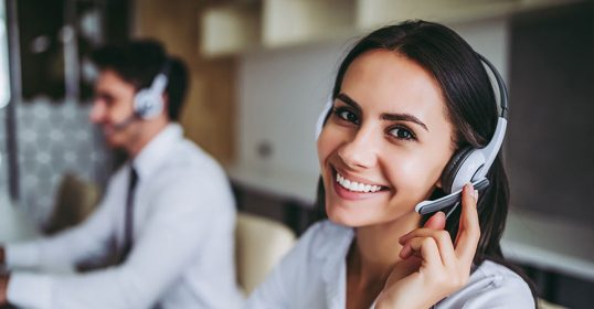 Woman using a headset to interpret over the phone